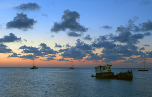 Caye Caulker, Belize - wreck at the cargo dock at sunset