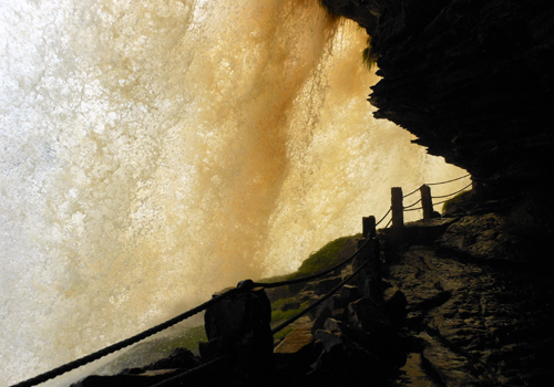 Canaima National Park crevice walk through El Sapo waterfall