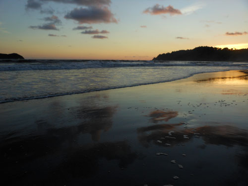 Costa Rica: Manuel Antonio beach, sunset reflection over Pacific