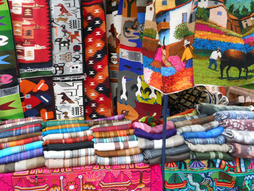Ecuador - Otavalo saturday market: stalls full of colours
