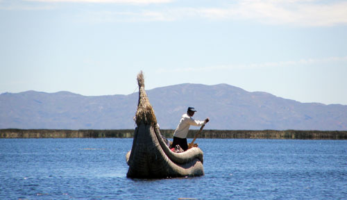 Lake Titicaca: reed boat on calm waters