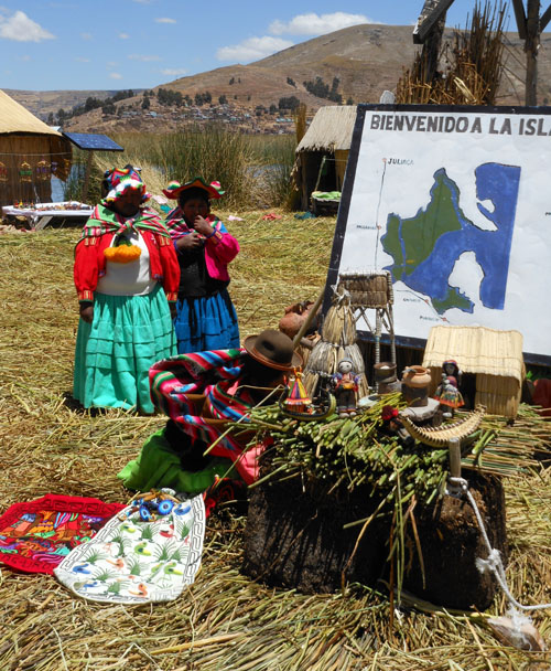 Peru, Lake Titicaca Floating Uros Island - traditional clothing, textiles and how island is build