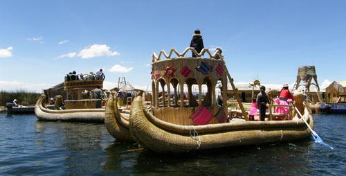 Peru, Lake Titicaca Floating Uros Island - local reed boat traffic