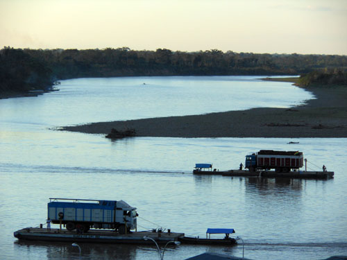 Bolivia, Rurrenabaque - ferry transporting cars across the shores of river Beni