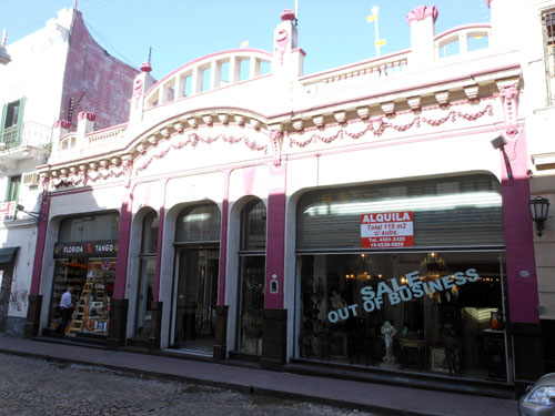 Argentina, Buenos Aires, San Telmo - interesting pink facade of a shop
