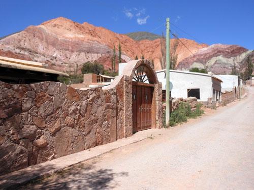 Argentina, Quebrada de Purmamarca - mountain of seven colours in the background of town