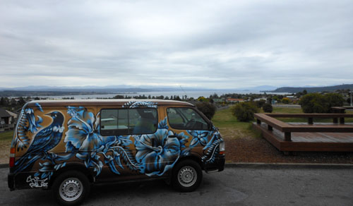 New Zealand, North Island - Taupo, panorama of town and lake (Escape Rentals campervan)