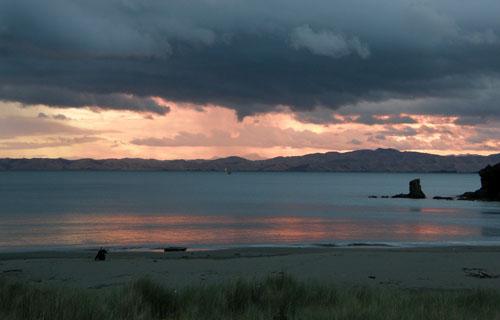 New Zealand, South Island - Whites Bay near Rarangi, intense red sky at sunset